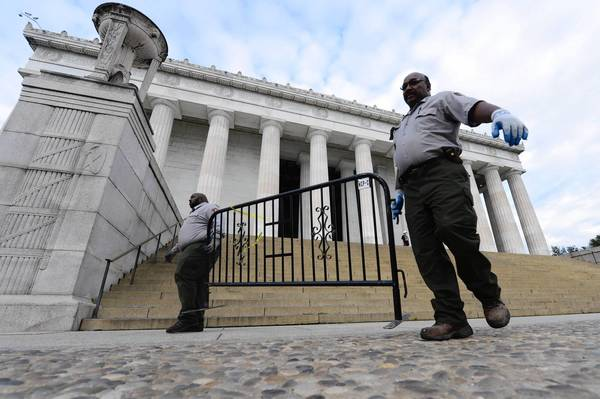 National Park Service employees move barriers at the Lincoln Memorial in Washington on Thursday, now that the federal government shutdown has ended.