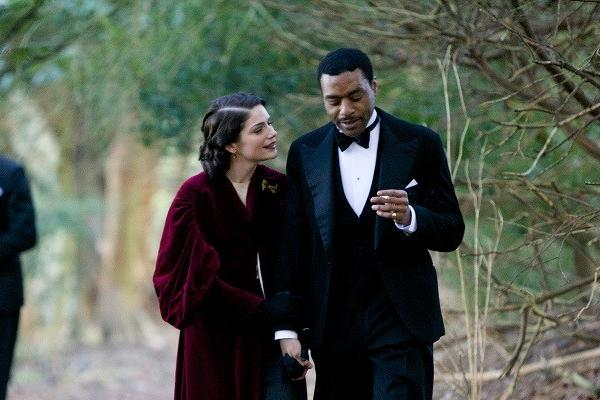 "Janet Montgomery, second from right, and Chiwetel Ejiofor, right, are caught up in love, jazz and murder in the Starz miniseries ""Dancing on the Edge."""