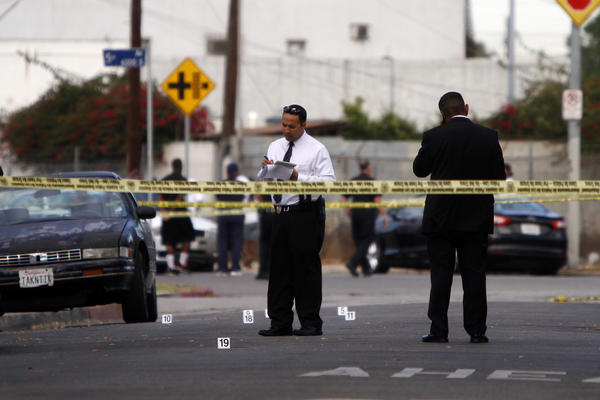 Police tape marks the area where two people were killed in a shooting this summer in South Los Angeles.