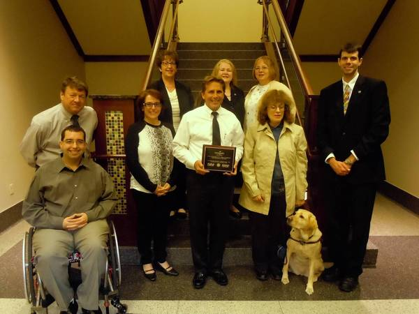 Ken Szymanski, the director of the Arlington Heights Mariano's Fresh Market, recently accepted the 2013 Disability Employment Awareness Award.