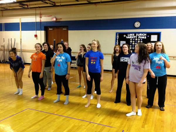 Lake Zurich High School's Orchesis dance team prepares for practice. The team was invited to dance at the Orange Bowl in January.