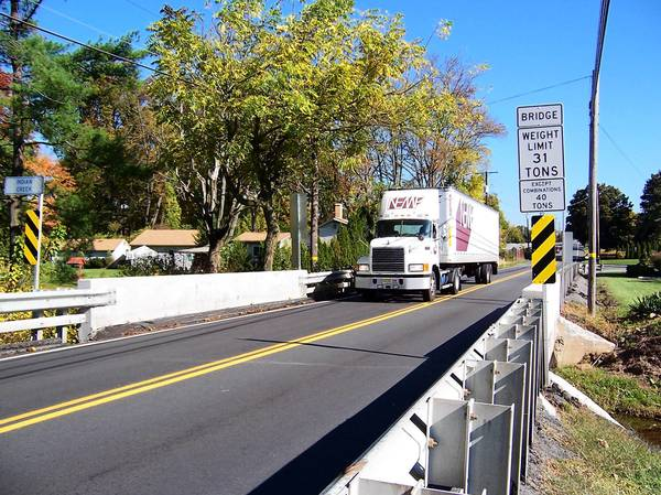 Fully loaded cement trucks, dump trucks and other heavy vehicles are prohibited from using the Route 100/29 bridge over Indian Creek in Upper Milford Township, but most tractor-trailers should be OK.