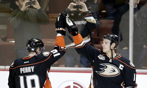 Ducks forwards Corey Perry, left, and Ryan Getzlaf celebrate a 6-0 victory over the New York Rangers on Oct. 10. Ducks Coach Bruce Boudreau is confident the team's power play will improve as the season continues.