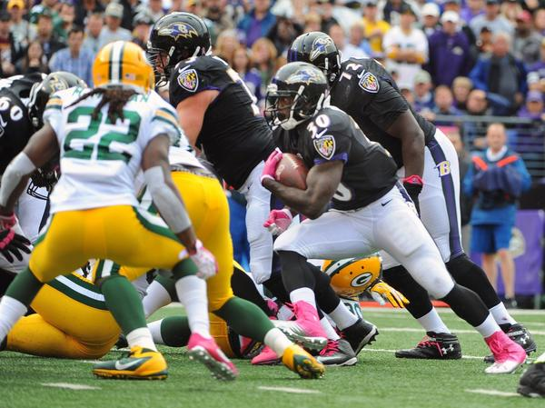 Ravens running back Bernard Pierce is stopped shy of the goal line against the Green Bay Packers.
