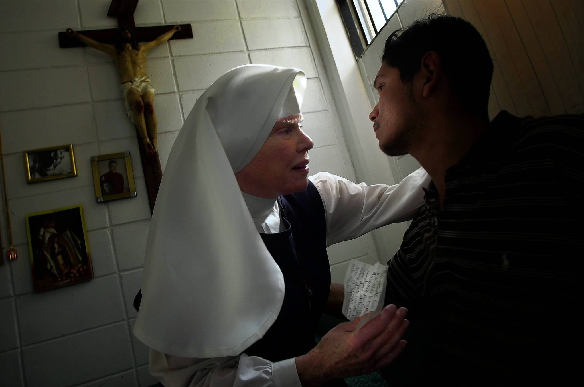 In this photo from 2002, Sister Antonia Brenner consoles inmate Jorge Villalobos inside her converted cell at the notorious La Mesa penitentiary in Tijuana. Brenner died Thursday at the age of 86.