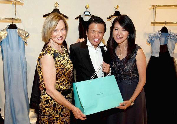 Dee Higby and Betty Huang present designer Zang Toi, center, a Tiffany & Co. thank-you gift.