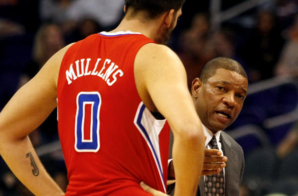 Clippers Coach Doc Rivers talks to reserve big man Byron Mullens during a preseason game Tuesday in Phoenix.