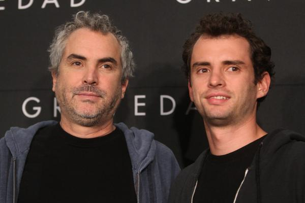 "Alfonso Cuaron, director of ""Gravity,"" participates with his son, Jonas, at a news conference in Mexico City."