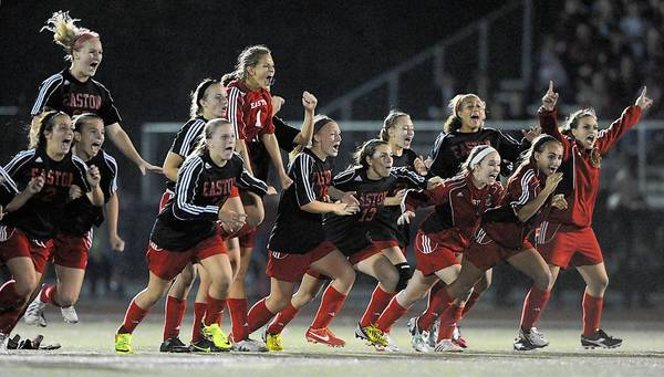The Easton High School girls soccer team begin to celebrate their shootout win over Parkland High School in the Lehigh Valley Conference girls soccer championship game held at Whitehall High School Thursday night.