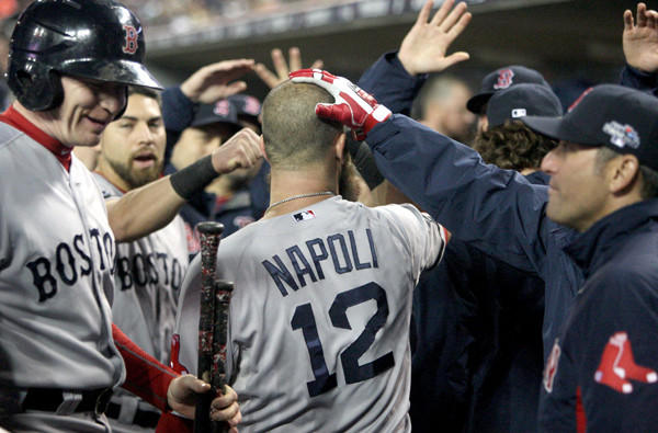 Red Sox first baseman Mike Napoli is congratulated in the dugout after his solo home run in the second inning against the Tigers during Game 5 of the American League Championship Series on Thursday night at Comerica Park in Detroit.
