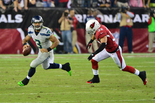 Seahawks quarterback Russell Wilson runs from Cardinals free safety Tyrann Mathieu during the first half.
