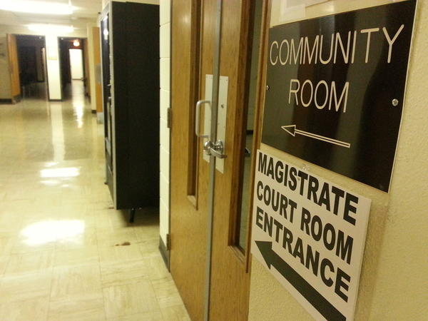 A sign directs the way to the new location of the courtroom for magistrate court, in the community room in the basement of the Brown County Courthouse Annex, 25 Market St.