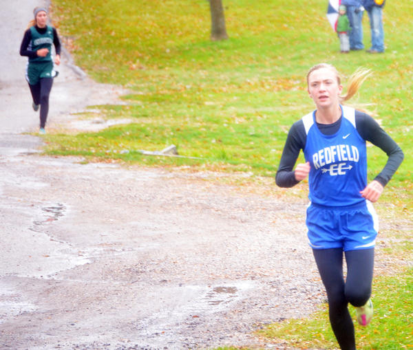 Redfield-Doland's Nicolette Schmidt has a big lead over Mikayla Prouty of Clark-Willow Lake during the Region 1A cross country meet on Thursday in Webster.