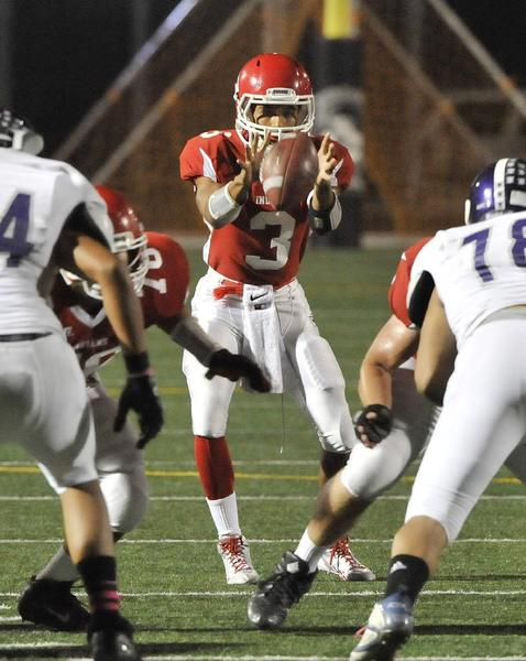 Burroughs' quarterback Andrew Williams takes a shotgun snap against Hoover in a Pacific League home game. The Indians won, 69-0, thanks to five touchdown passes from Williams. (Tim Berger/Staff Photographer)