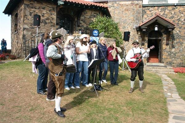 Musicians Ron Kwas and Freddi Meier with visitors during a recent Heublein Tower Toot. This year's event will be Oct. 19 and 20.
