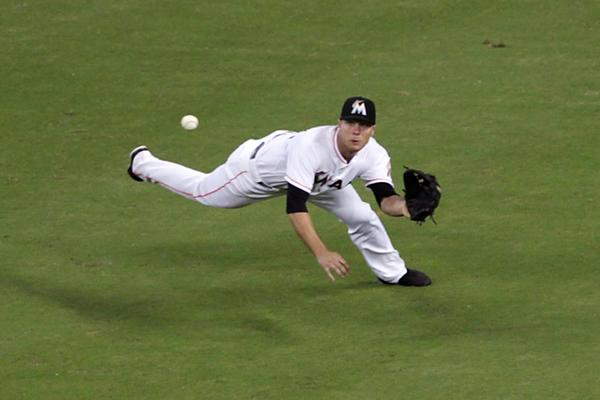 Center fielder Jake Marisnick of the Miami Marlins makes a diving catch against the New York Mets during the fifth inning at Marlins Park on Aug. 1, 2013 (Photo by Marc Serota/Getty Images)