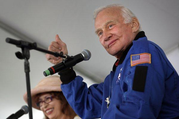 Legendary astronaut Buzz Aldrin, shown during a 2010 interview with The Times' Patt Morrison, has been named grand marshal of the 2013 Hollywood Christmas Parade.