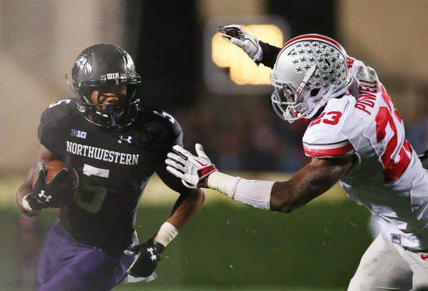 Northwestern Wildcats running back Venric Mark (left) runs against Ohio State Buckeyes defensive back Tyvis Powell.