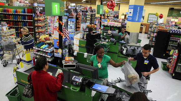 Shoppers check out at the Wal-Mart Neighborhood Market at 2844 N. Broadway in June.