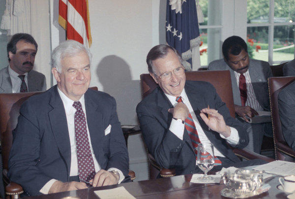 Former House Speaker Tom Foley sits next to former President George H.W. Bush.