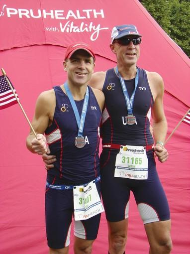 Jeffrey Schumann, right, the Enfield superintendent of schools, has competed in 127 triathlons. His most recent race, in London this September, was his first at an international level. He finished 19th out of 90 racers in his age bracket. Here he is pictured with his brother, William Schumann, who also competed.
