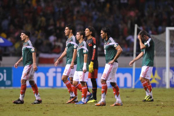 Mexican players react after losing 2-1 to Costa Rica in their Brazil 2014 FIFA World Cup Concacaf qualifier match at the Nacional stadium in San Jose, on October 15, 2013. Costa Rica qualified to the 2014 World Cup, while Mexico is forced to play New Zealand in a play-off.