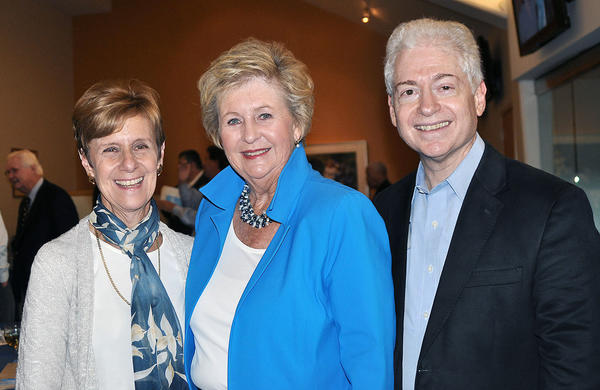 Mindy Stein, left, and her husband, Gene, right, greet Linda Seiter, honoree at the Hathaway-Sycamores Dodger party.