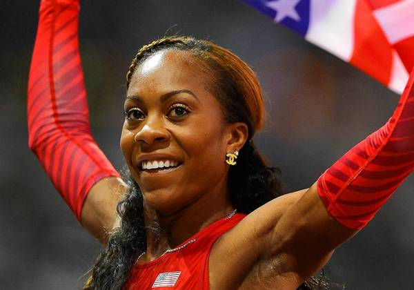 Sanya Richards-Ross celebrates winning the women's 400-meter race at the 2012 Olympics.