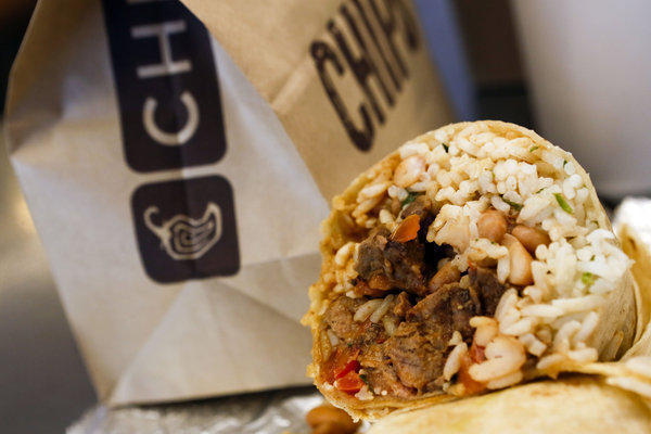 Chipotle said it plans to raise prices in 2014. The stock traded at an all-time high Friday.