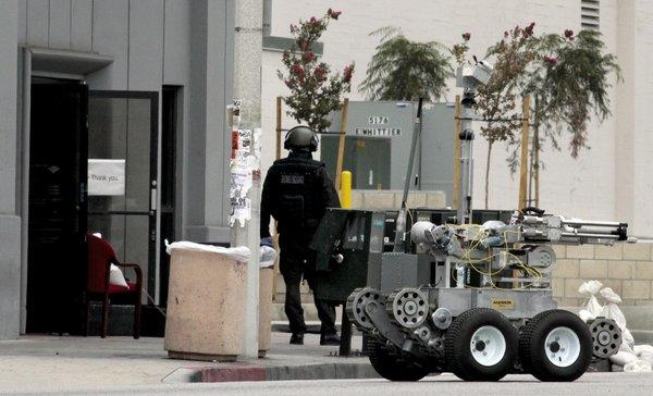 A robot and bomb squad were sent to the scene of an East L.A. bank branch where a robbery occurred.