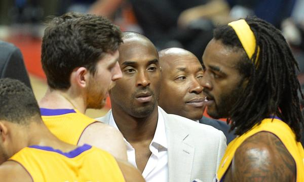 Lakers star Kobe Bryant, center, listens to teammates Ryan Kelly, left, and Jordan Hill during the Lakers' preseason loss to the Golden State Warriors in Beijing on Friday.