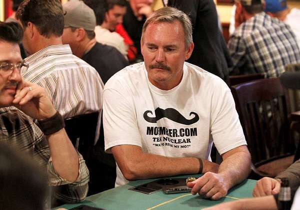 In a file photo from last Movember, former Angels pitcher Jim Stowell plays in the Newport–Mesa Movember Team Nuke poker fundraiser at the Newport Rib Co.