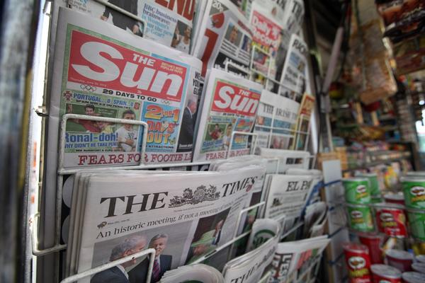 Copies of News Corp.'s newspaper titles, The Sun and The Times, are seen for sale on a newsagent's stand in London, U.K.