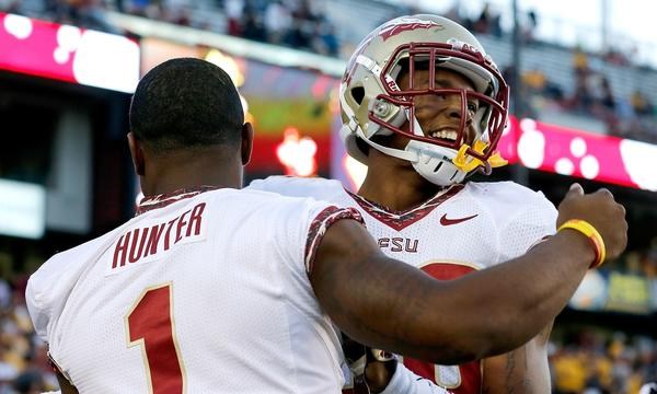 Florida State's P.J. Williams, right, celebrates an interception with teammate Tyler Hunter during a win over Boston College last month. The Seminoles are helping the ACC regain some clout in the college football world.