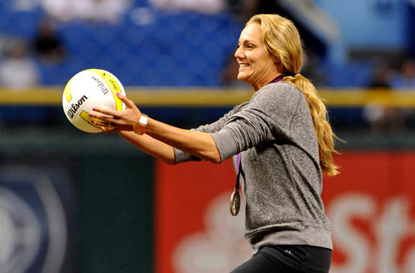 Beach volleyball star Jen Kessy, wearing her Olympic medal, takes the mound to serve up the ceremonial first pitch before the Rays-Red Sox game last month in Tampa, Fla.
