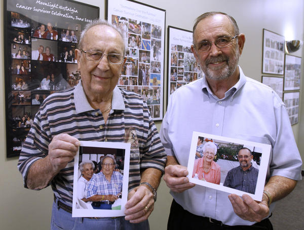 Gaspard Sossoyan, of Silver Lake, left, and Richard McDaniel, of La Crescenta, right, holding portraits of their wives and who are part of a breast cancer support group, are shown at the Glendale Memorial Hospital Breast Cancer Center in Glendale on Wednesday, Oct. 16, 2013. Their wives passed away in 2011 and 2012 respectively.