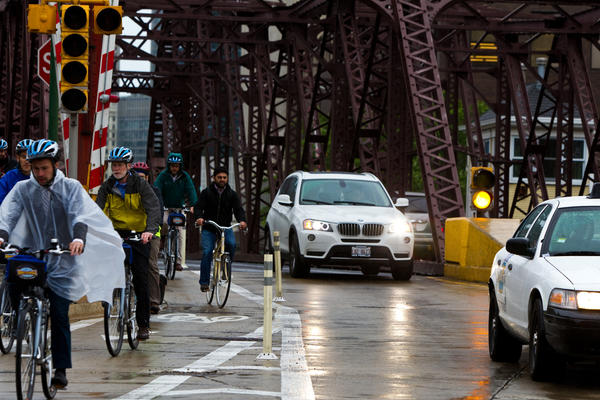 Bicyclists take some of the first rides in a protected bike lane on the Kinzie Street bridge after it was opened in May 2012.