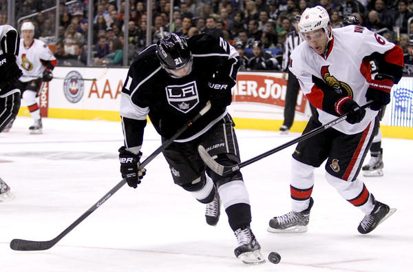 Kings right wing Matt Frattin battles Senators right wing Bobby Ryan for the puck during the first period of a game last week at Staples Center.