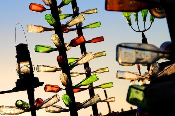Glass bottles catch the light at Elmer's Bottle Tree Ranch near Victorville.