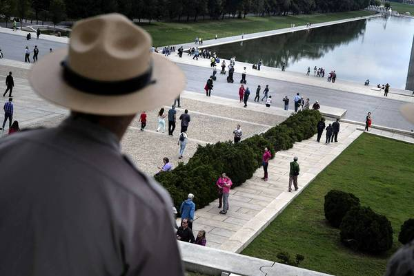 Park rangers watch as visitors return to the Lincoln Memorial after the U.S. government shutdown. The crisis sparked interest in reform efforts pioneered by California to create a more moderate body of elected officials.