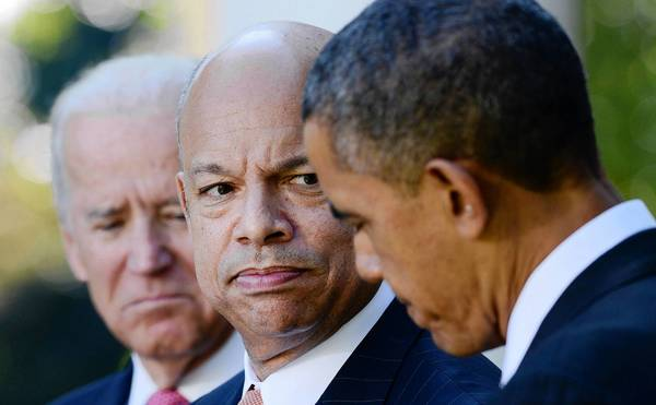 Jeh Johnson, center, has been nominated to be secretary of the Department of Homeland Security.