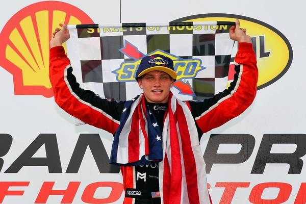 Sage Karam on the podium after winning the Firestone Indy Lights Series race in Houston.