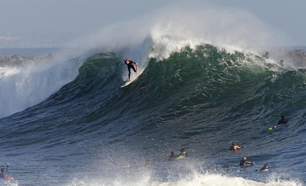 Newport's Bobby Okvist charges a set wave at the Wedge recently. Bodysurfers want their time in the water too.