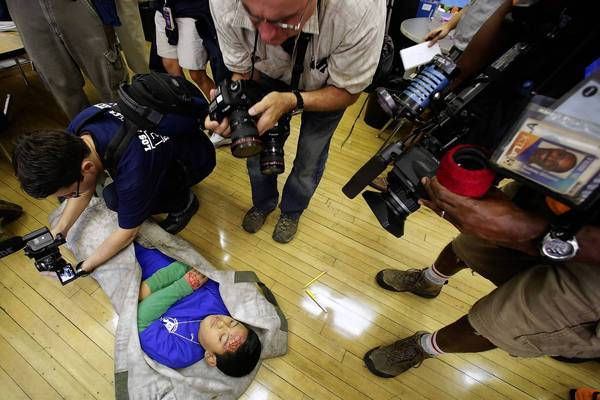 Leobely Hernandez, 11, a student at Rosemont Avenue Elementary School in L.A., participates as an injured victim in Thursday's Great California ShakeOut.