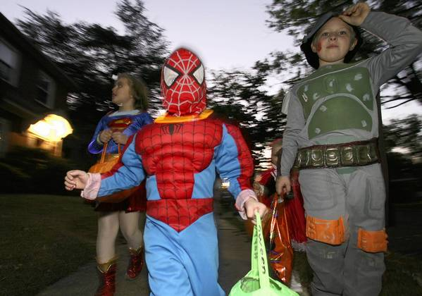 Jayson Mitton as Spider-man leads Petra Morgan as Supergirl and Taliesin Trzell as Boba Fett out for some trick-or-treating Wednesday night in Hampton. No Mags, No Sales, No Internet, No TV