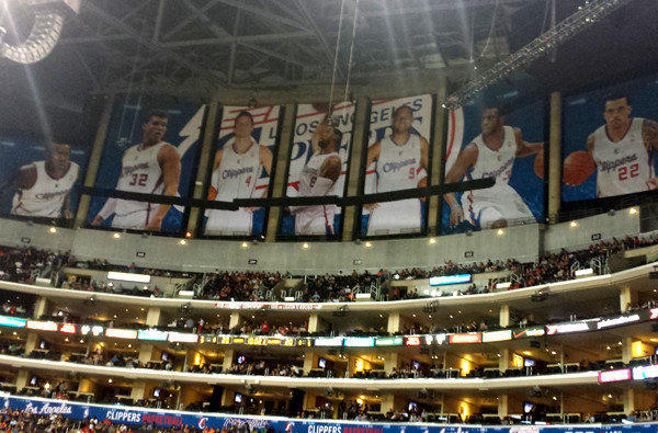 Banners of Clippers players block the view of the Lakers' championship banners at Staples Center.