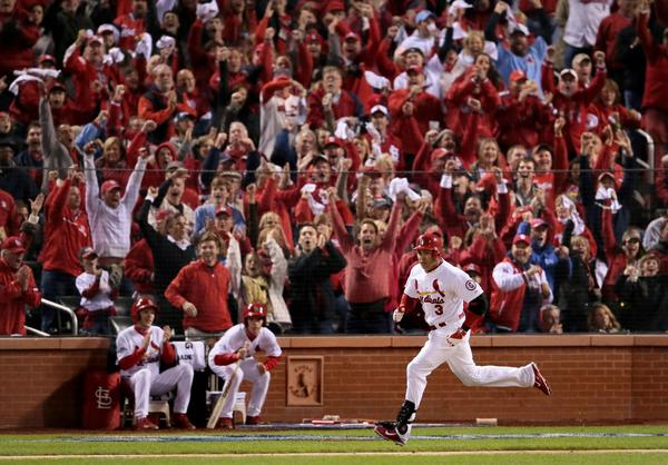 The Cardinals' Carlos Beltran rounds the bases after his RBI double drove home Matt Carpenter in the third inning.