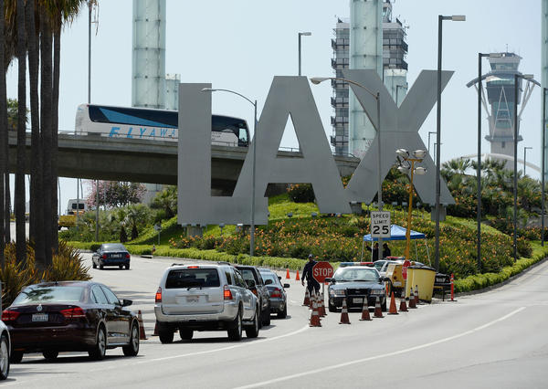 APRIL 15 2013: Cars stop at a checkpoint at the entrance of Los Angeles International Airport after security.