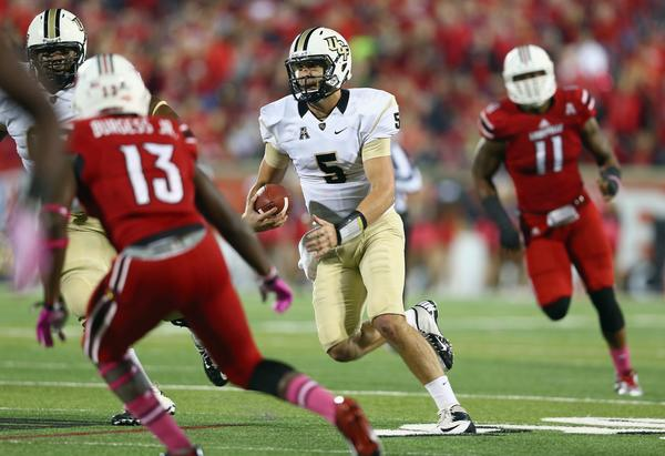 Central Florida's Blake Bortles runs with the ball during the game against Louisville.