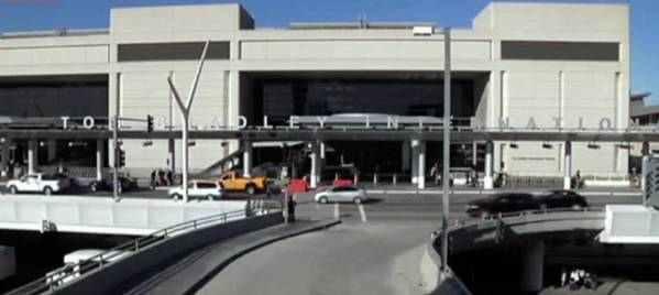 An unexploded dry ice bomb was found near the Tom Bradley International Terminal. Police have made a second arrest.